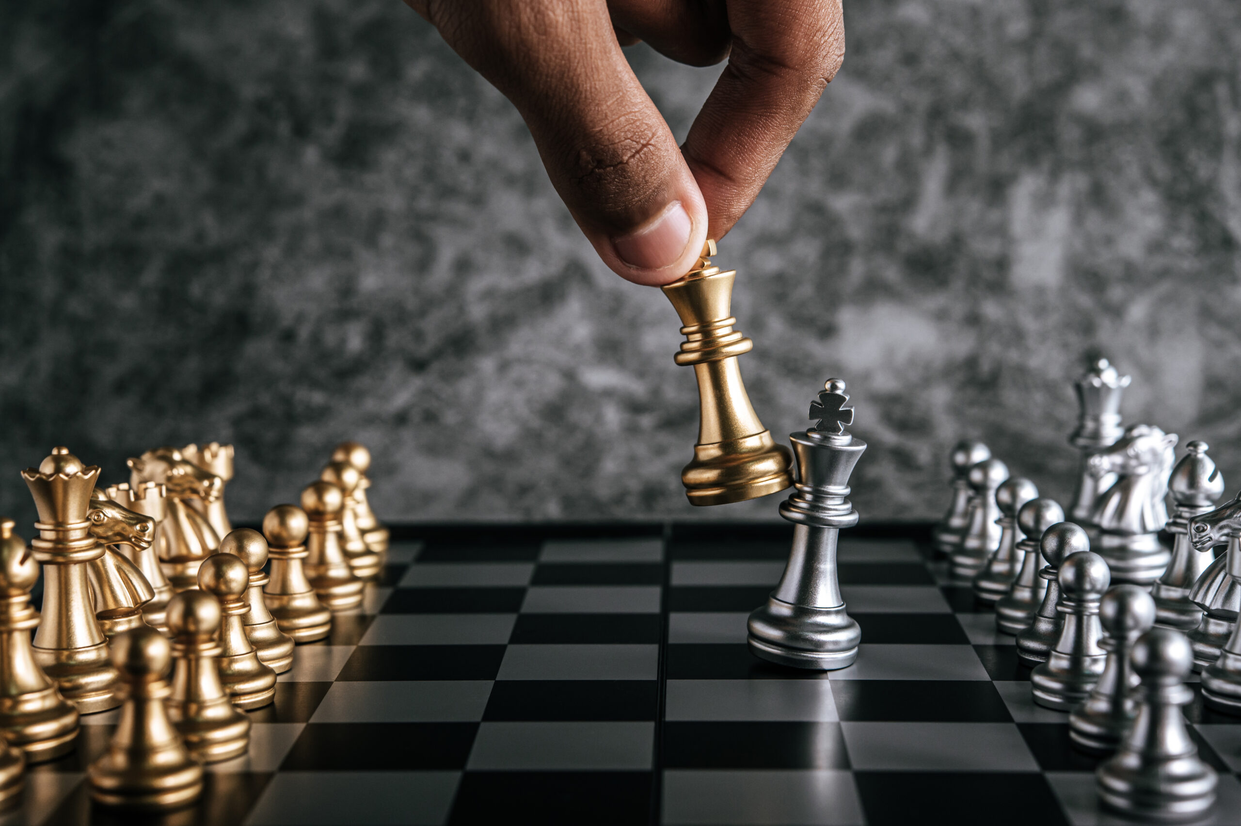 Hand of man playing chess for business planning and comparison of metaphor, selective focus
